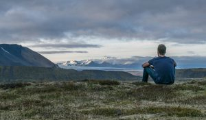 image of man looking at mountains in the distance